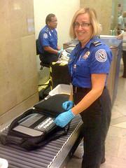 TSA agent (photo from http://www.flickr.com/photos/mobileedgelaptopbags/4119819621/in/photostream/)